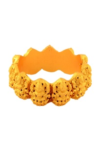 Gold finish bracelet with carved effect