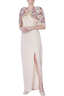 Beige sleevless gown with cape