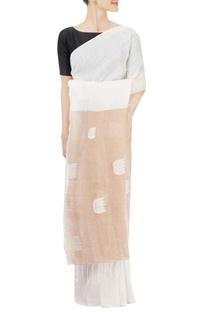 White & brown sari with lotus motif