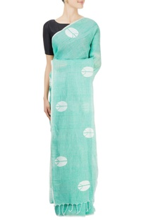 Green sari with peace sign motifs