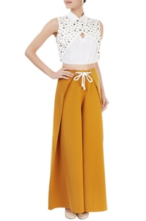 White eyelet top & ochre yellow pants