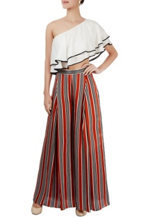White one shoulder top & striped trousers