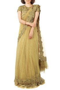 Cream sari with sequined lehenga petticoat
