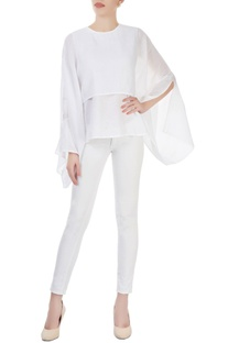 White layered top with dramatic sleeves