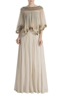 White palazzo pants with tasseled cape