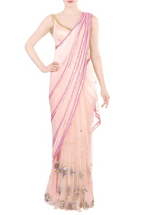 Shaded peach embellished sari with blouse.