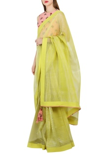 Green sari with salmon pink...