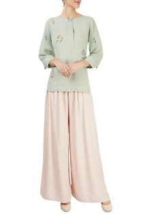 Mint green top with floral motifs