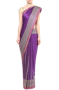 Purple embellished sari with pink highlights