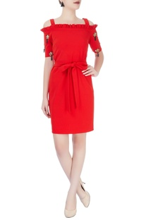 Red dress with tasseled sleeves