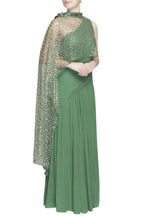 Green one-shoulder gown with sequin drape