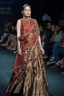 Brown & forest green lehenga with draped knot blouse
