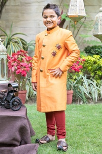 Orange bug sherwani with churidar