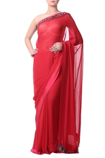 Red sari with charcoal gray stonework