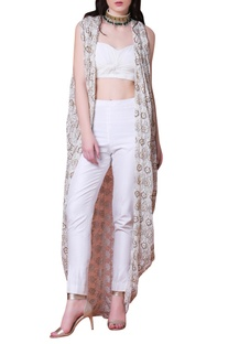 White pants & cowl back cape