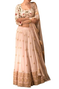 Salmon pink embroidered lehenga set.