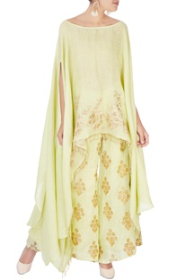 Green palazzos with gold embellishments