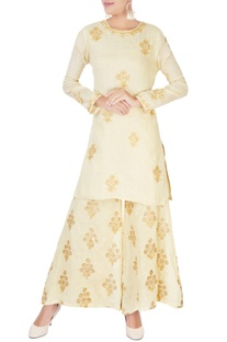 Beige short kurta in embellishments