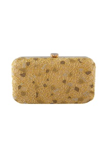 Beige clutch with yellow bead embellishments