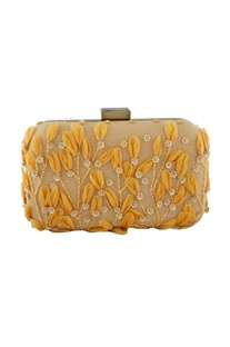 Orange clutch with floral motifs