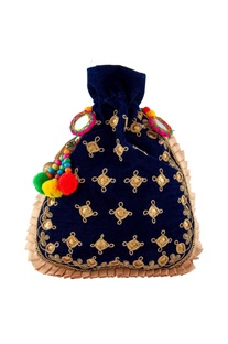 Blue potli with colorful pompom accents