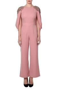 Pink jumpsuit with metallic tassels