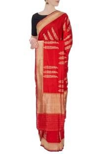 Red silk sari with unstitched blouse fabric
