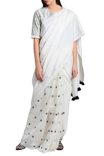 White sari in hand embroidery