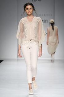 White poncho top & jeans