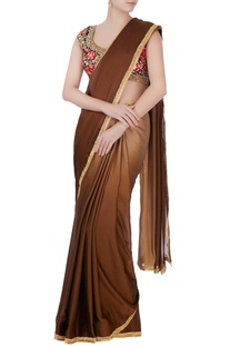 Brown sari with floral blouse & petticoat