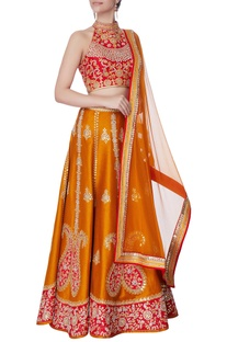 Red halter blouse with raw silk lehenga & dupatta