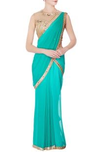 Sea green pre-draped sequin sari with blouse