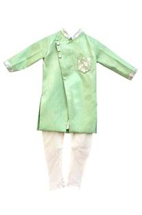 Green kurta with white churidar pants