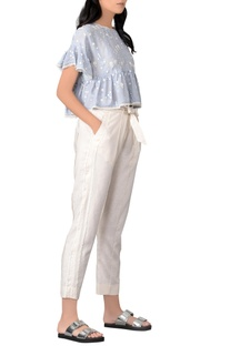 Blue ruffle blouse & white pants