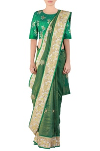 Green embroidered tissue sari with blouse