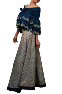 Blue off-shoulder ruffle top & brocade skirt