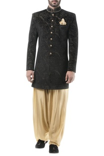 Black velvet zari work achkan with golden dhoti pants