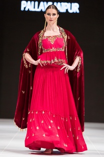 Red tiered lehenga with blouse & velvet cape