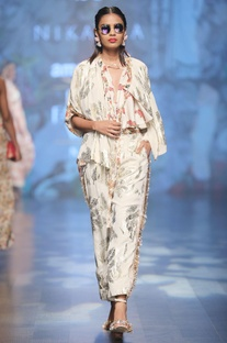 Ivory crepe pleated flared blouse with printed high-waisted pants & foil printed jacket
