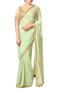 Mint green nylon net embroidered saree with blouse