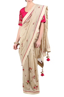 Ivory chanderi saree with hot pink embroidered blouse