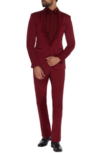 Maroon  textured lapel jacket with maroon shirt, trousers & black pocket square