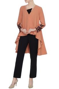Cadmium orange cape with embellished cuffs