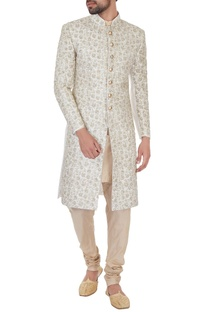 Cream silk jaal & zari embroiered sherwani with kurta & churidar