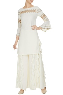 Off white royal georgette cut work geometric blouse with frilled palazzos