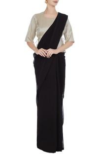 Silver cotton peplum style blouse.