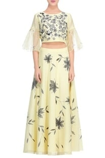 Pale yellow applique work blouse with lehenga