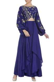 Embroidered ballon sleeves top with layered skirt.