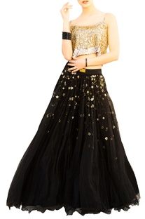 Black net layered flared lehenga with gold sequin blouse