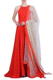 Carrot orange crepe printed embroidered halter neck kalidar kurta with churidar & mukaish net embroidered dupatta